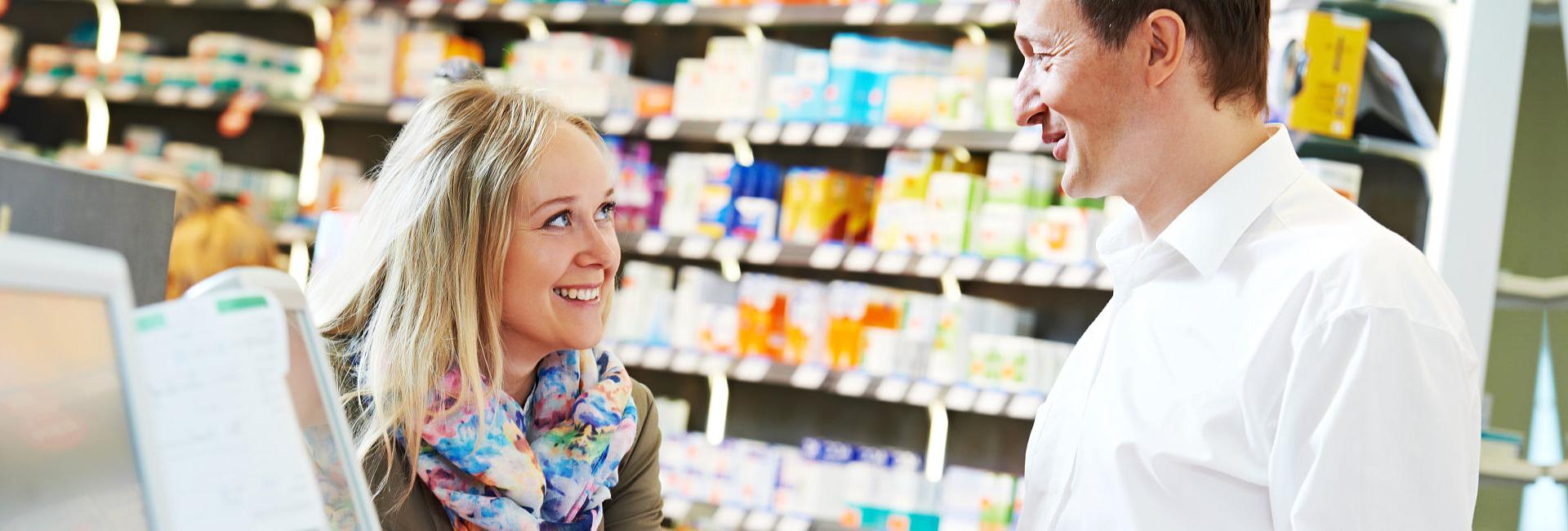 pharmacist assisting a customer